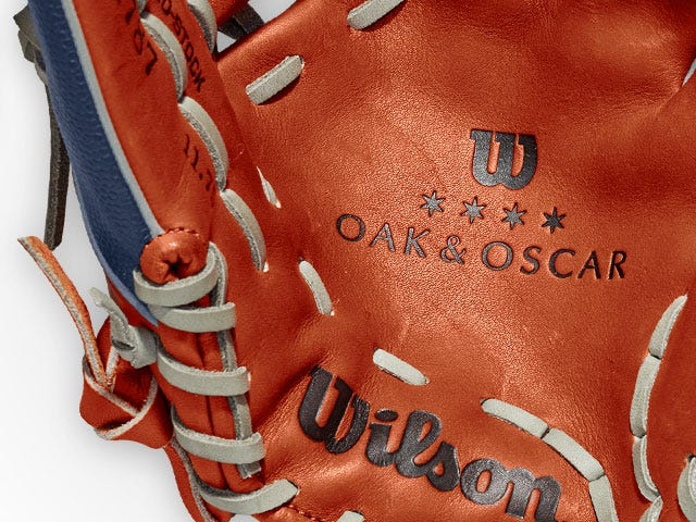 Palm of glove with Wilson and Oak and Oscar logos stamped in leather