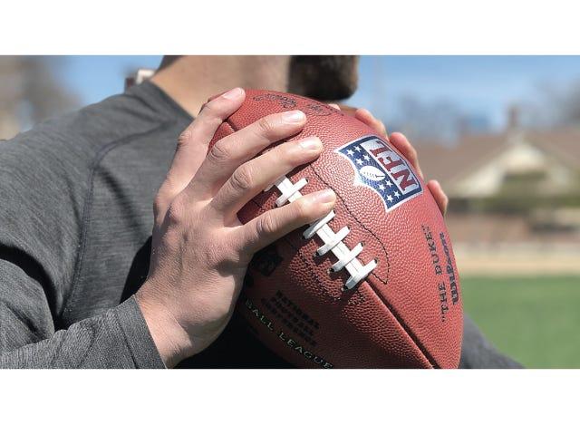 Football player holding NFL Duke Football