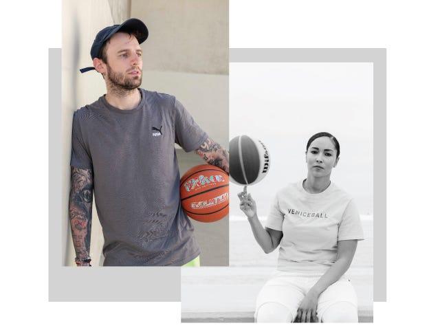 Two basketball players holding Evolution Balls