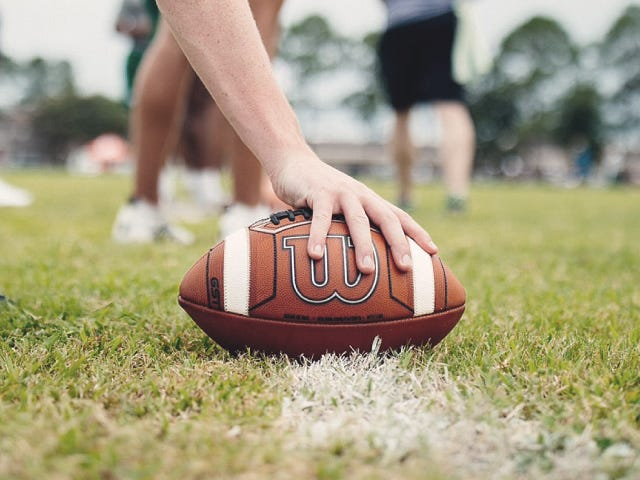 Playing touching a football onto the field