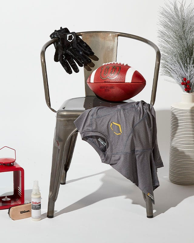 Collection of Wilson football items on a barstool