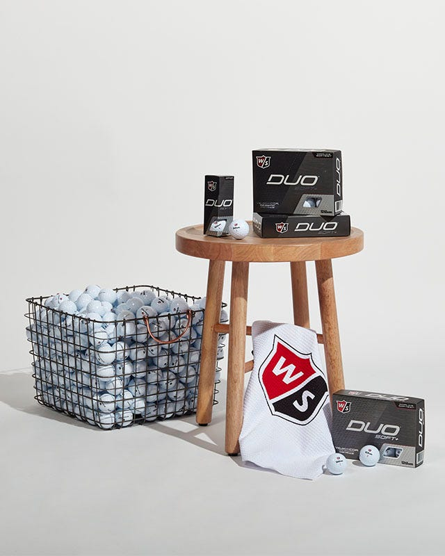 Collection of Wilson golf items on a barstool