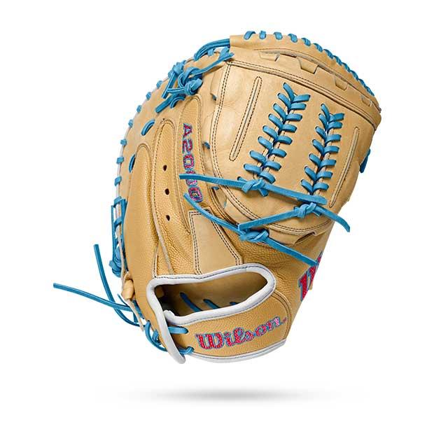 brown softball mit with blue stitching