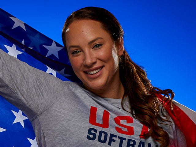 Portrait of Val Arioto smiling holding an American Flag