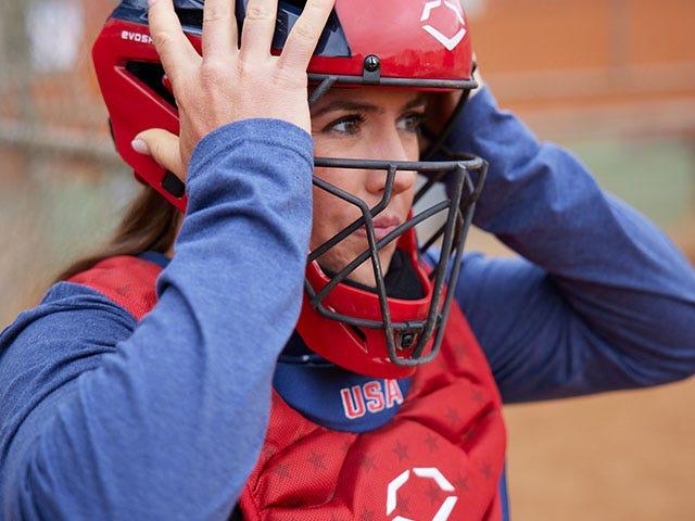 Amanda Chidester wearing softball catcher's helmet