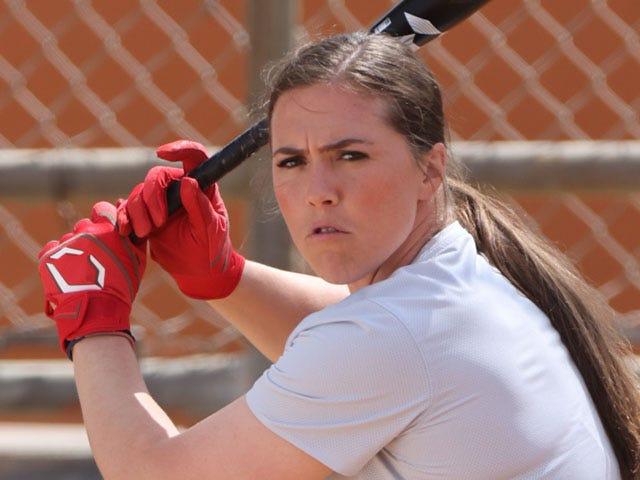 Amanda Chidester holding bat, ready to swing