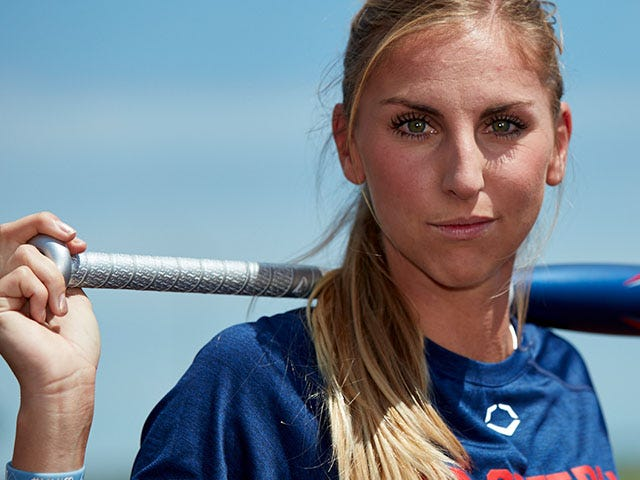 Aubree Munro holding bat over her shoulders