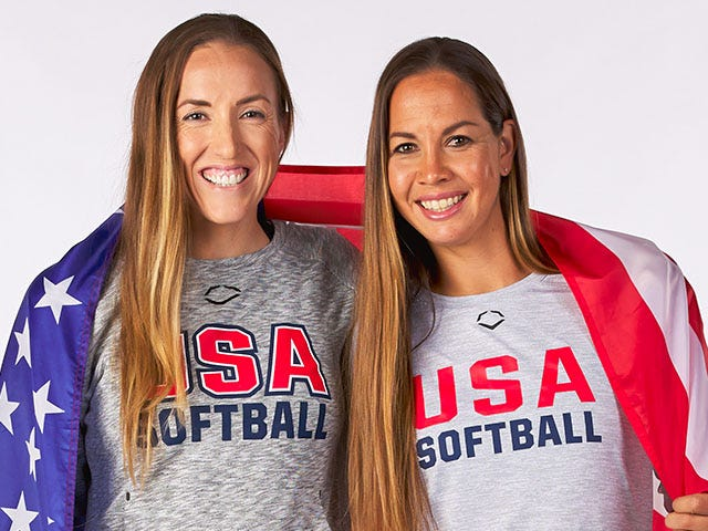portrait of Monica Abbott and Cat Osterman wrapped in American flag