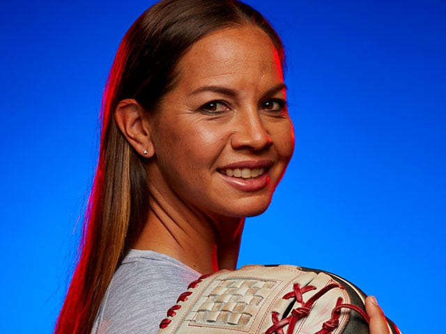 Portrait of Cat Osterman smiling holding a softball glove