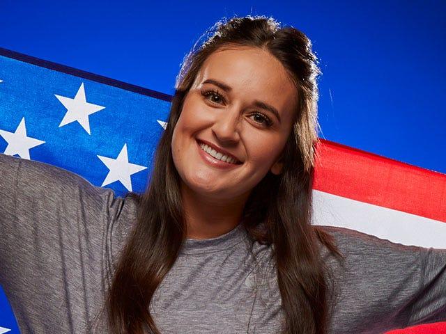 Portrait of Delaney Spaulding smiling holding an american flag