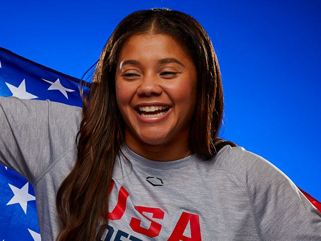 Portrait of Kelsey Stewart smiling holding an american flag
