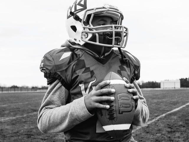 Quarterback preparing to throw football