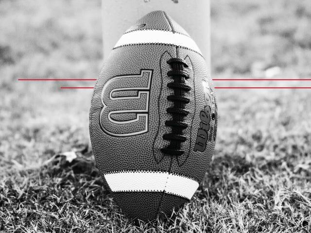 Wilson GST Composite football on field