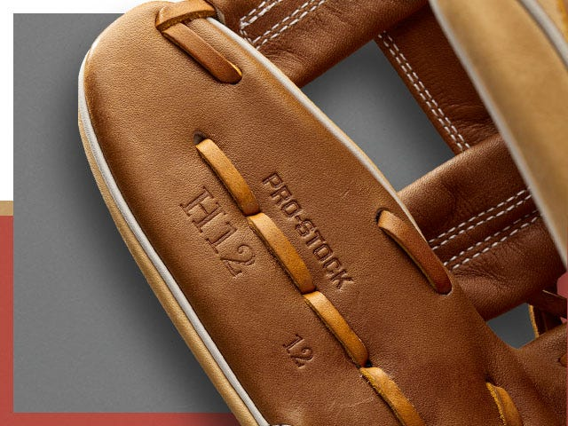 brown baseball glove with Pro-stock inset into leather