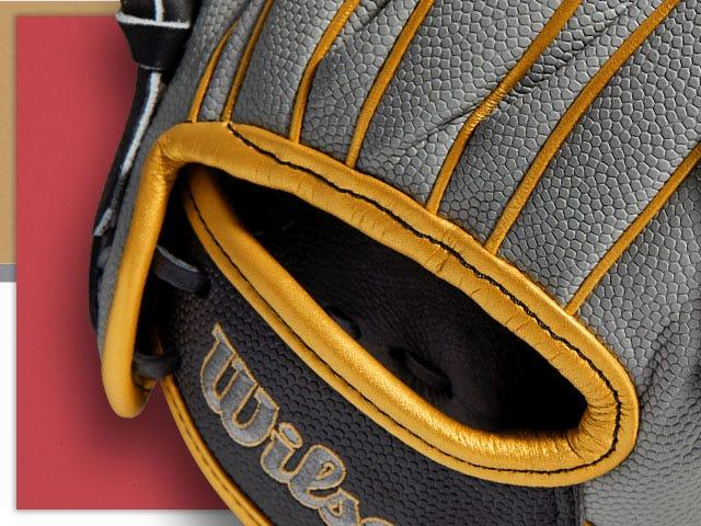 Gray and yellow baseball glove with Wilson logo