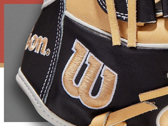 brown baseball glove with W of Wilson logo in tan stitching