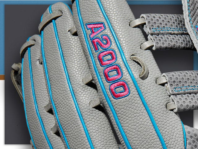 close up of gray baseball glove with blue and red A2000 logo stitched in