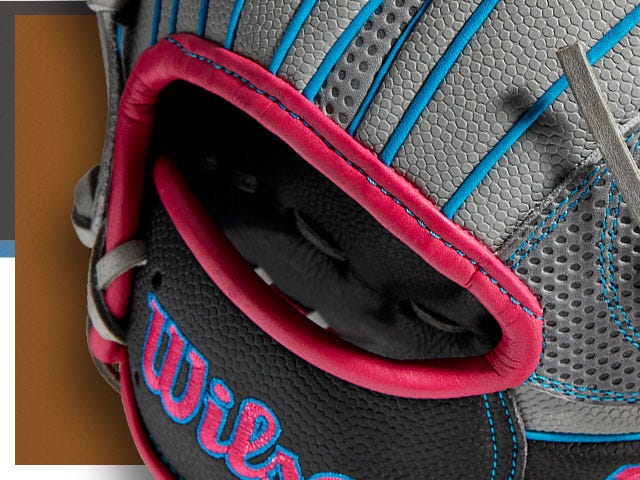 close up of gray baseball glove with red details