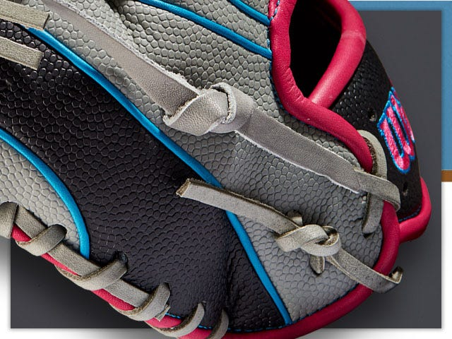 close up of gray blue and red baseball glove showing stitching