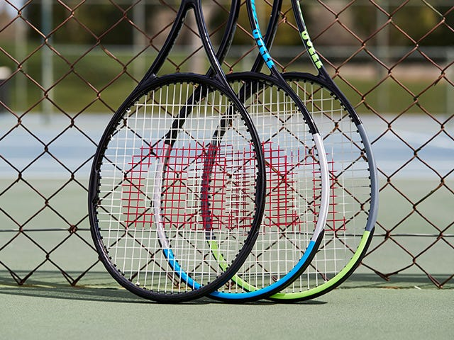Pro Labs rackets resting against a tennis net