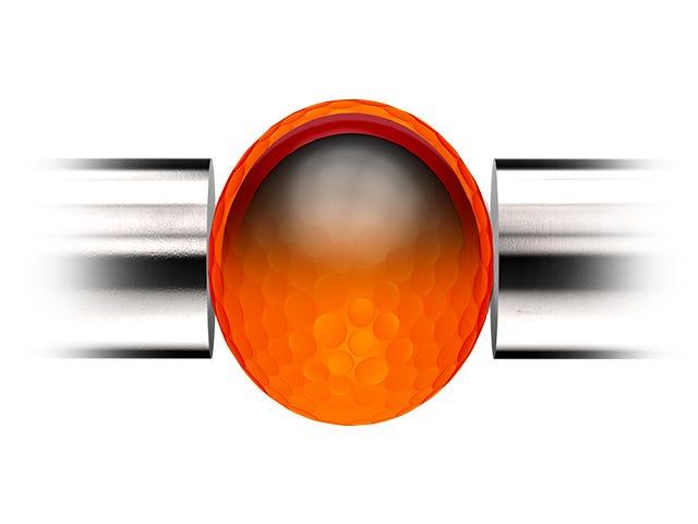 orange golf ball being compressed