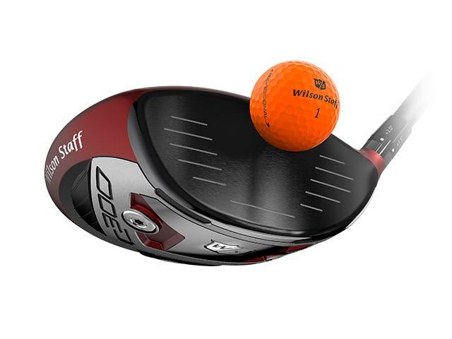orange golf ball being hit off face of driver