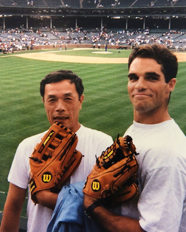 Wilson's Glove Guru Shigeaki Aso and Baseball General Manager Jim Hackett holding Wilson baseball gloves at Wrigley Field