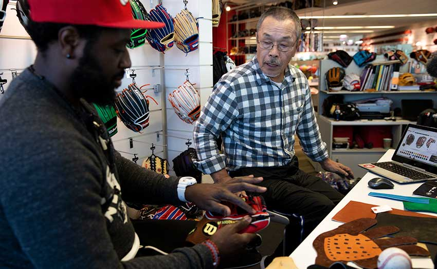 Wilson's Shigeaki Aso collaborating on a baseball glove design with MLB player Brandon Phillips