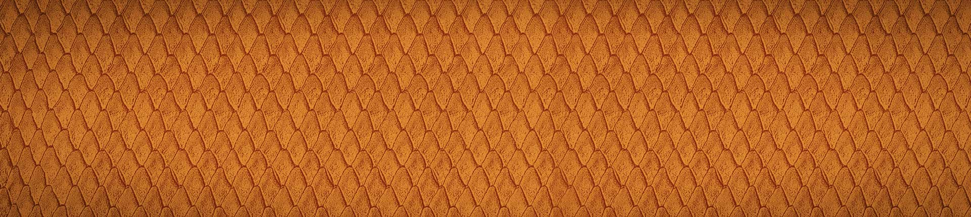 Closeup image of gold colored Wilson baseball glove material