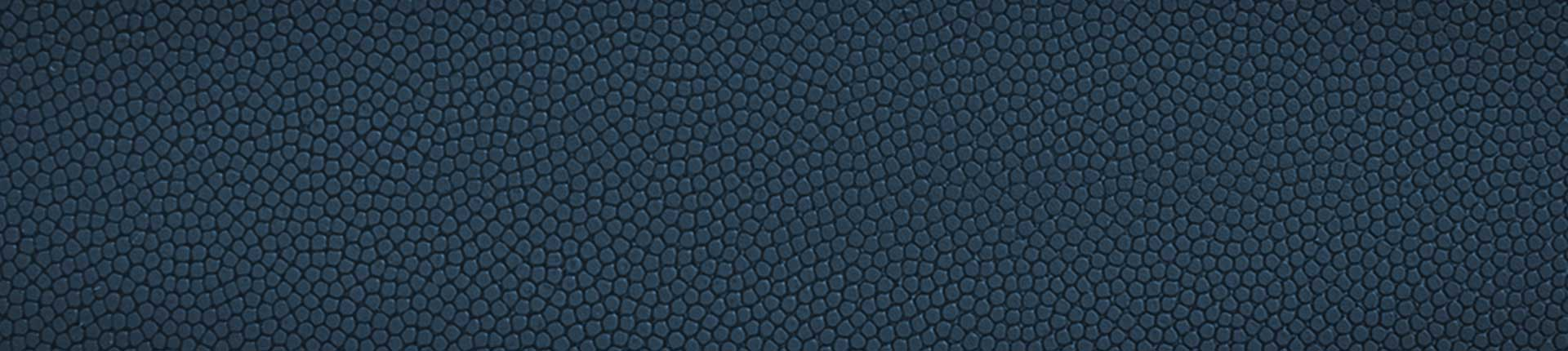 Closeup image of navy blue Wilson baseball glove leather