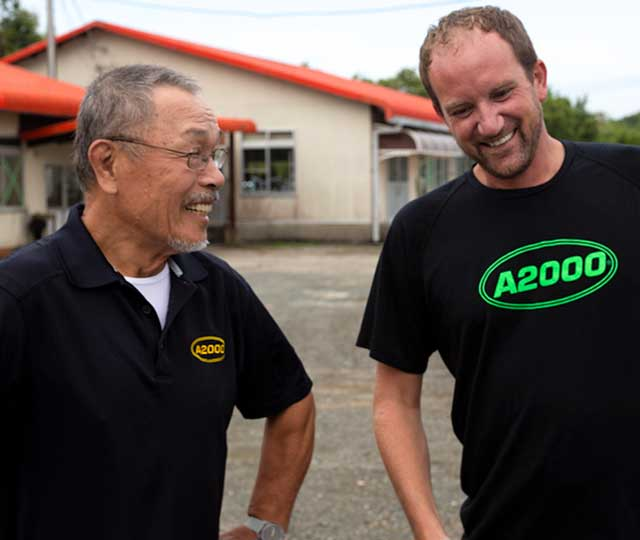 Wilson Ball Glove Master Craftsman Shigeaki Aso and Product Manager Ryan Smith laughing and wearing A2000 shirts