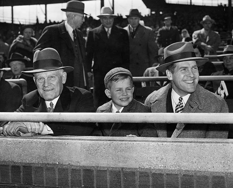 Thomas E. Wilson, founder of Wilson Sporting Goods, at Wrigley Field with son, Edward Foss Wilson and one of his grandsons