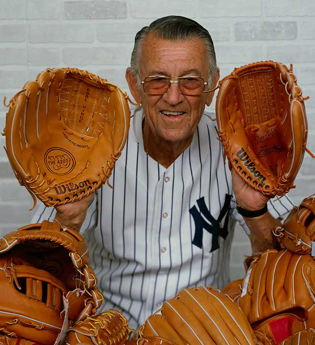 "Vernon ""Lefty"" Gomez posing with A2000 baseball gloves as a member of the Wilson team"