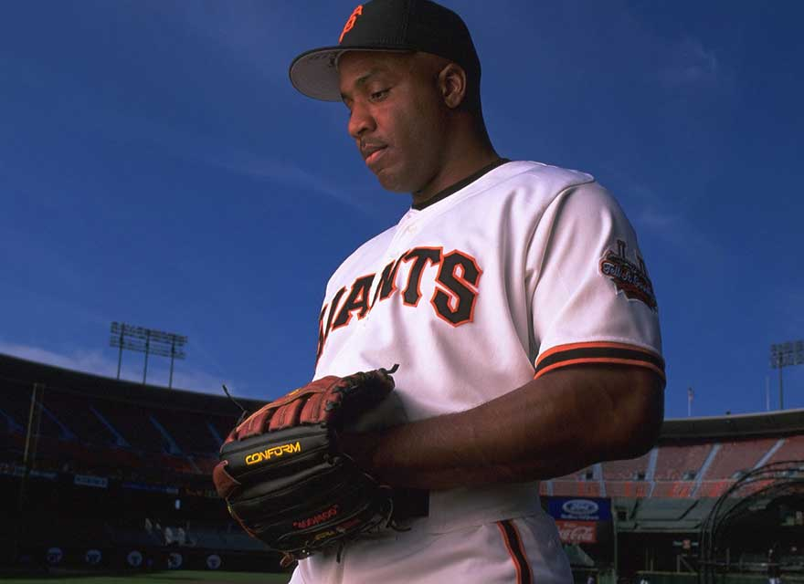 Barry Bonds in his Giants uniform holding his Wilson baseball glove
