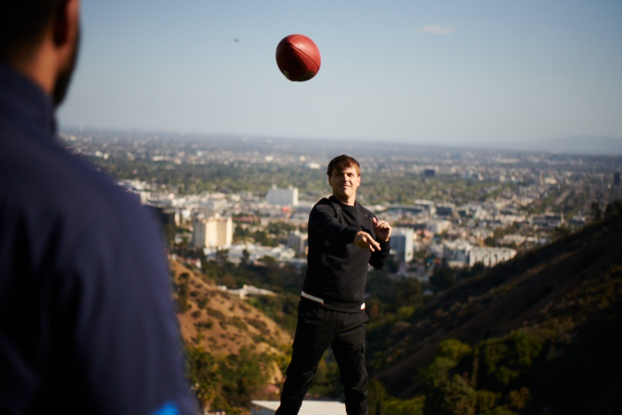 Ad Staff throwing a football