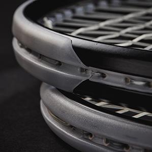 closeup of tennis racket bumpers