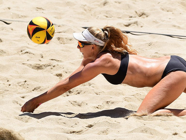 volleyball player diving for ball