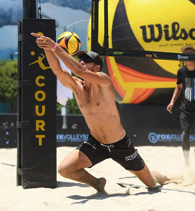 volleyball player diving for a save