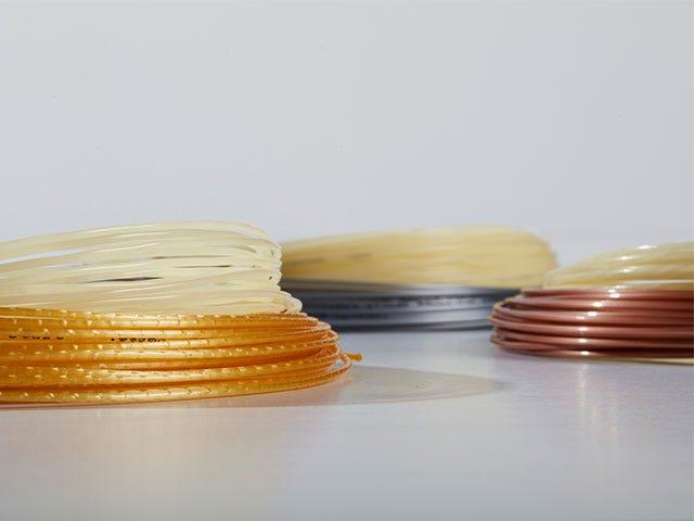 Different reels of tennis strings