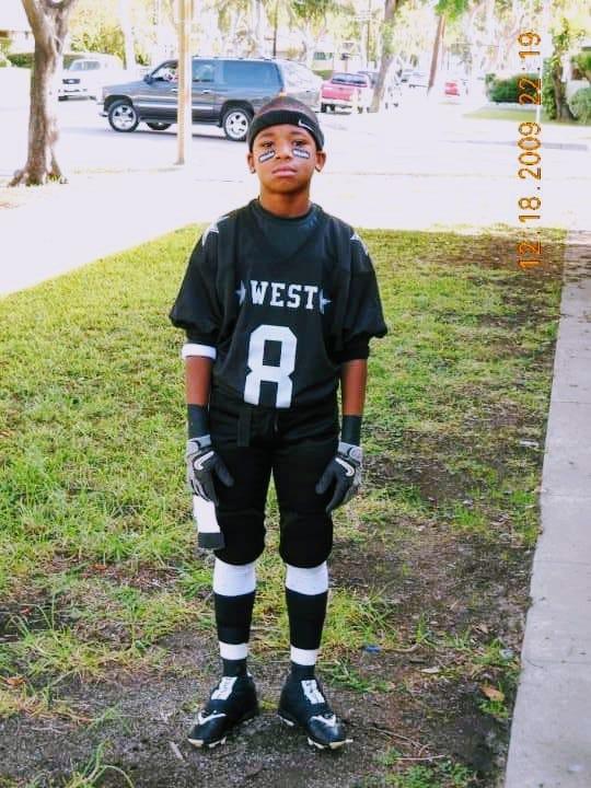 Darren in his youth football uniform