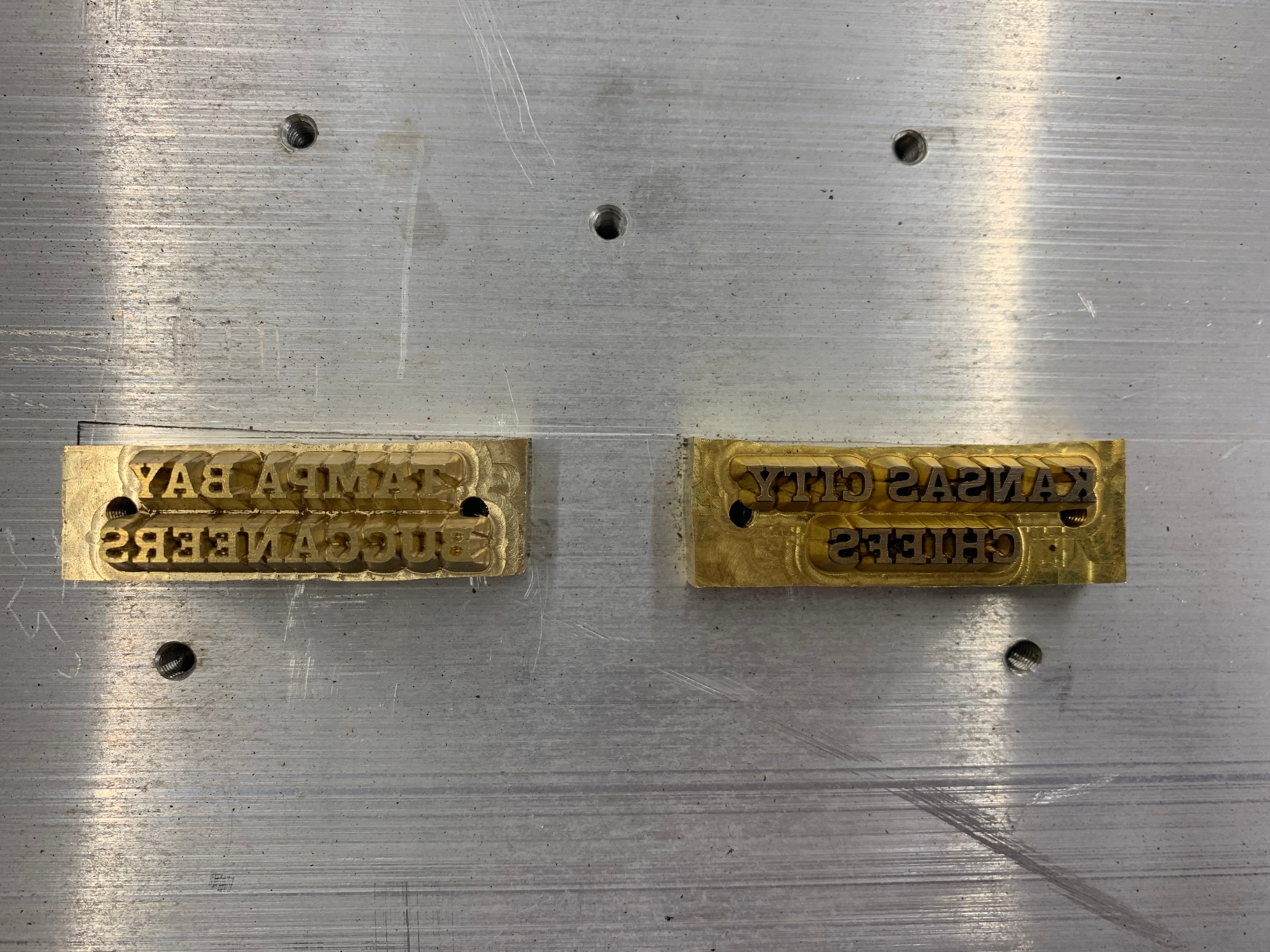 a graphics plate with Chiefs and Buccaneers team names