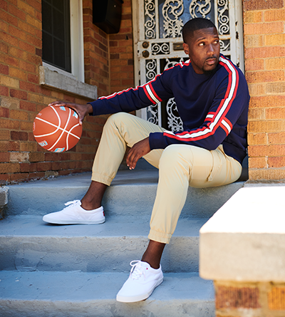 Jahmal Cole on his porch with a Wilson basketball