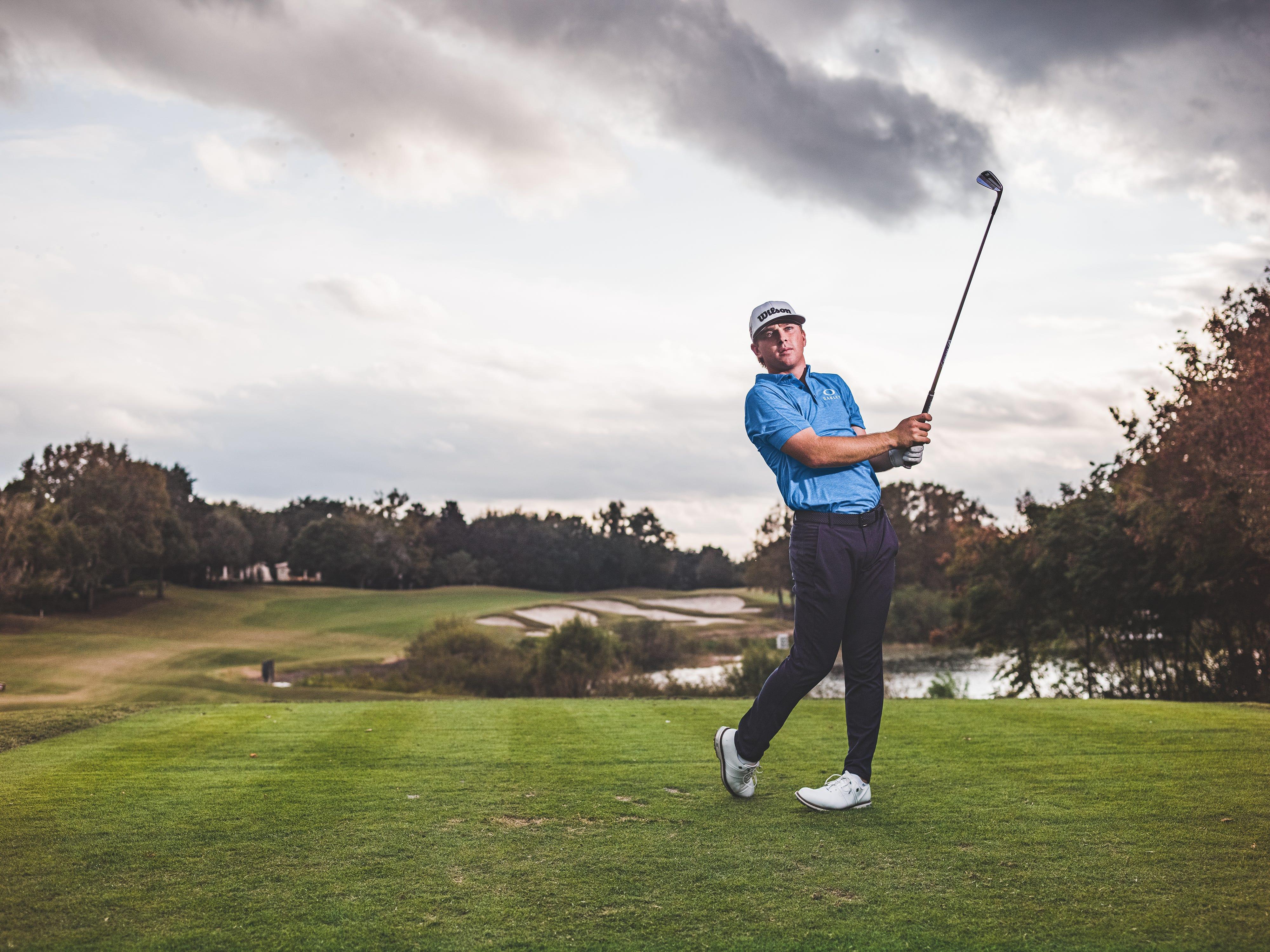 John Augenstein swinging a golf club