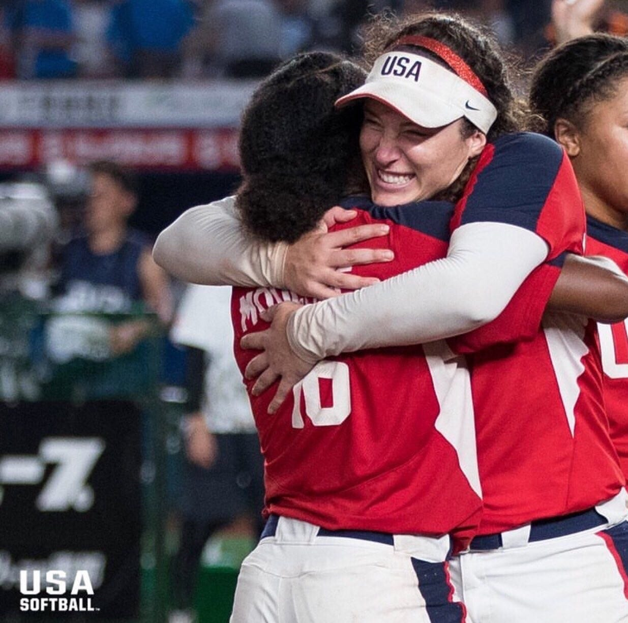 Valarie Arioto and teammate hugging