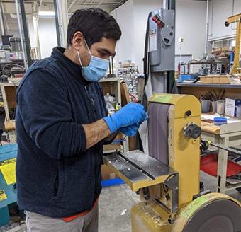 Wilson LABS engineer with aerosol box