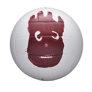closeup of a white volleyball with a red handprint on it
