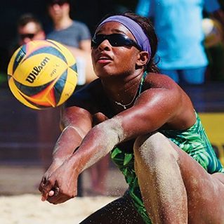 crissy jones making a shot with a Wilson AVP volleyball