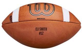 closeup of a GST football with laser engraving