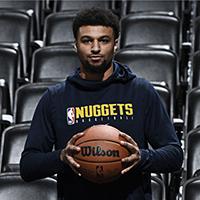 Jamal Murray in a Denver Nuggets shirt holding a Wilson basketball