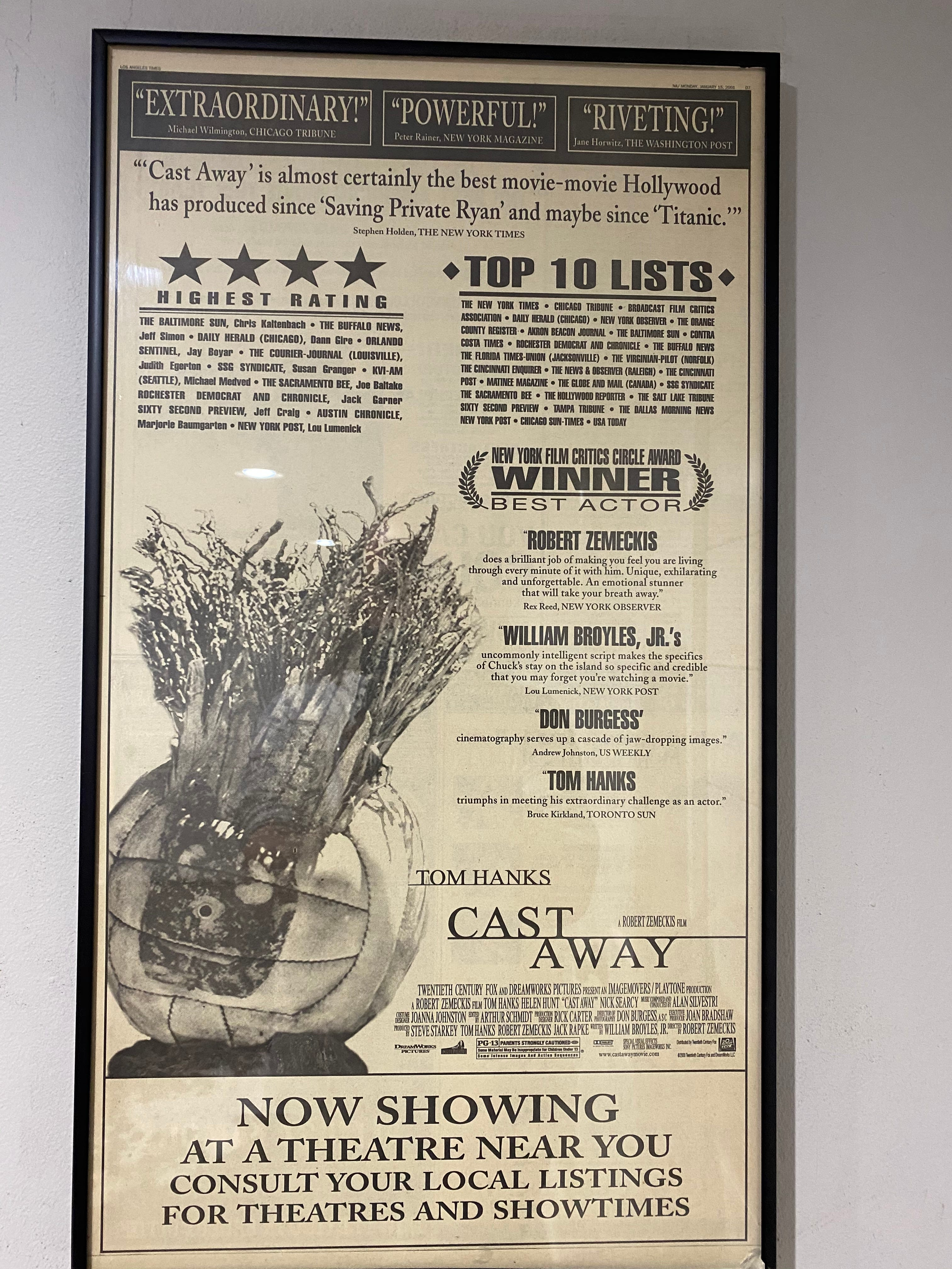 A framed Cast Away movie poster